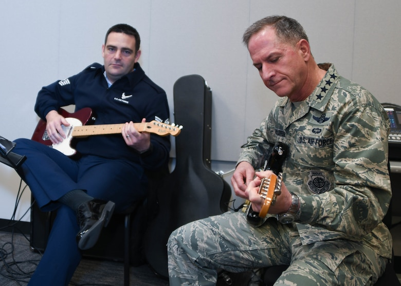 Air Force Chief of Staff Gen. David L. Goldfein and Tech. Sgt. Christopher Dunning, 531st Air Force Band, Air National Guard Band of the Southwest member, plays guitar during an impromptu jam session with the entire band at Naval Air Station Fort Worth Joint Reserve Base, Texas, Jan. 29, 2017. Goldfein visited several other squadrons during his visit to the 136th Airlift Wing, Texas Air National Guard. (Air National Guard photo by Senior Airman De'Jon Williams)