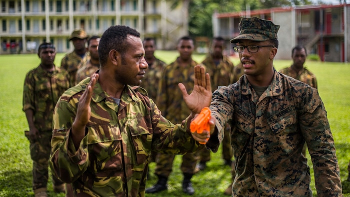 U.S. Marine Sgt. Jai Curley, a squad leader with Battalion Landing Team 1st Battalion, 4th Marine Regiment, 11th Marine Expeditionary Unit, teaches a Papua New Guinea Defense Force service member how to close with and disarm an assailant during escalation of force tactics training at Taurama Barracks, Papua New Guinea as part of a theater security cooperation engagement, April 16. TSC's like the one conducted alongside the PNGDF, help to enhance military capabilities with partner nations in the Indo-Asia-Pacific region, and serve to strengthen their respective abilities to respond to emerging crises