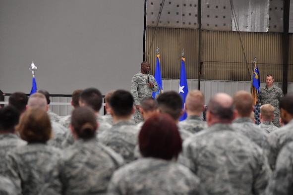 "Col. Rodney Lewis, 319th Air Base Wing commander, addresses Airmen of Grand Forks Air Force Base during his final all call as the base commander on Grand Forks AFB, N.D., April 14, 2017.  During Lewis' final all call, he shared with Airmen, ""Remember that to serve is to serve others."" (U.S. Air Force photo by Airman 1st Class Elijaih Tiggs)"