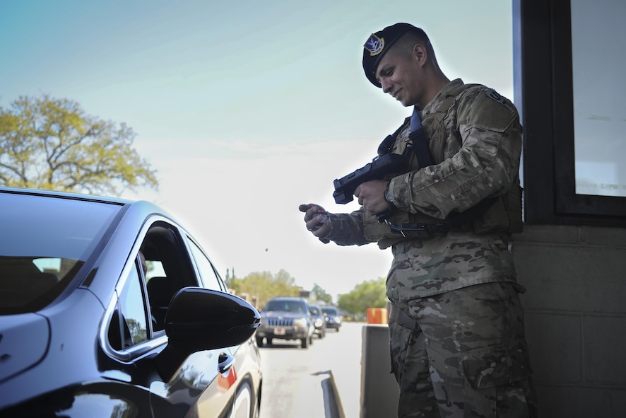 Airman Salvador Villa, an installation entry controller with the 1st Special Operations Security Forces Squadron, verifies a Common Access Card using the revamped Defense Biometrics Identification System at Hurlburt Field, Fla., April 7, 2017. DBIDS is a force-protection tool in the form of a handheld ID card scanner. The scanner is used at gate checkpoints to improve traffic flow and boost security. (U.S. Air Force photo by Airman 1st Class Dennis Spain)
