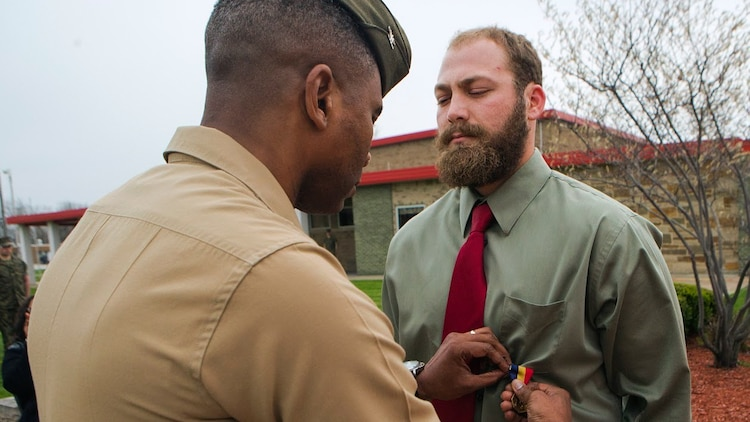 Col. Ricardo Player (left), the Force Headquarters Group chief of staff, Marine Forces Reserve, pins the Navy and Marine Corps Medal on Cpl. Nathan Bryson (right), a Marine Corps veteran who most recently served as a motor transport operator for Headquarters and Support Battalion, School of Infantry East, Camp Lejeune, North Carolina, at the 3rd Battalion, 25th Marine Regiment headquarters in Brook Park, Ohio, April 14, 2017. Bryson was awarded the medal for his actions in 2014 when he and a fellow Marine saved a man from a burning vehicle. The Navy and Marine Corps Medal is awarded for acts of heroism despite personal risk and is the highest honor one can achieve for non-combat service. (U.S. Marine Corps Photo by Cpl. Dallas Johnson/Released)