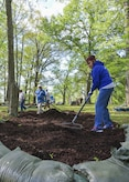 Volunteers rake mulch at a Civil War earthworks site on Fort Eustis during Earth Week events at Joint Base Langley-Eustis, Va., April 17, 2017. The 733rd Civil Engineer Division organized mulching, sandbagging and spreading grass seed at this site to help prevent further erosion. (U.S. Air Force photo/Tech. Sgt. Katie Gar Ward)