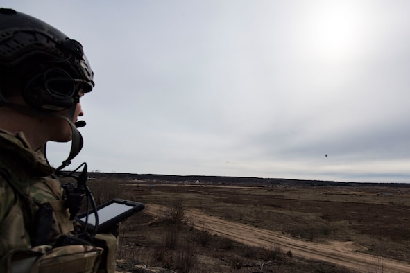 U.S. Air Force Senior Airman Tyler Marketon, 19th Air Support Operations Squadron Tactical Air Control Party specialist, watches as an A-10C Thunderbolt II attacks simulated targets during a close air support exercise, April 13, 2017, at Camp Grayling, Mich. To further build interoperability and hone their unique skillset, members of the German air force Air Ground Operations Squadron travelled to the U.S. to partner with the 19th ASOS and conduct a close air support exercise working with A-10C Thunderbolts IIs and F-16 Fighting Falcons. (U.S. Air Force photo by Airman 1st Class Daniel Snider)
