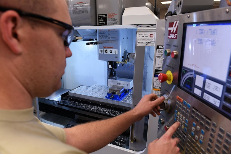 U.S. Air Force Senior Airman Andrew Herrick, 19th Maintenance Squadron Aircraft Metals Technology journeyman, operates a computer numeric controlled machine April, 7, 2017, at Little Rock Air Force Base, Ark. The metals tech Airmen can mass produce 100 to 200 aircraft parts at a time, reducing wait times for aircraft parts by more than half. (U.S. Air Force photo by Airman 1st Class Kevin Sommer Giron)