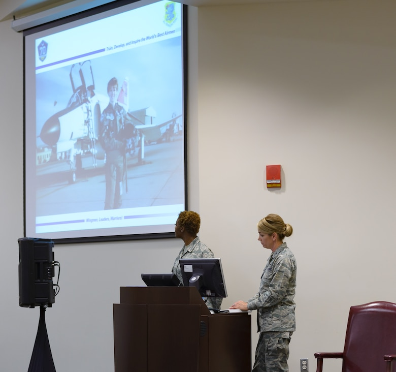 Col. Michele Edmondson, 81st Training Wing commander, gives a presentation on the role of women in the military during the Women's History Month Information Fair and Panel event at the Roberts Consolidated Aircraft Maintenance Facility Auditorium, March 31, 2017, on Keesler Air Force Base, Miss. Edmondson spoke about leadership, trust and the roles women will play in the military's future.  (U.S. Air Force photo by Andre' Askew)