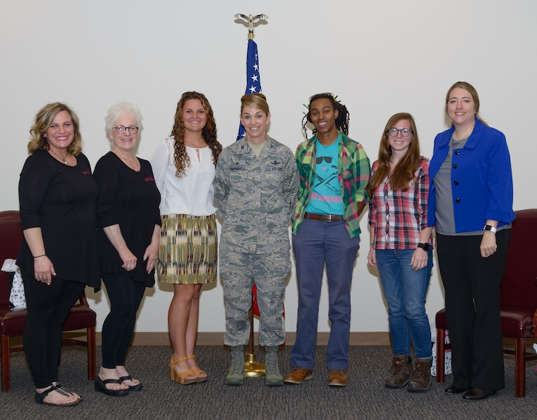 Col. Michele Edmondson, 81st Training Wing commander, poses for a group photo with panel members during the Women's History Month Information Fair and Panel event at the Roberts Consolidated Aircraft Maintenance Facility Auditorium, March 31, 2017, on Keesler Air Force Base, Miss. The diverse panel members represented successful women. (U.S. Air Force photo by Andre' Askew)