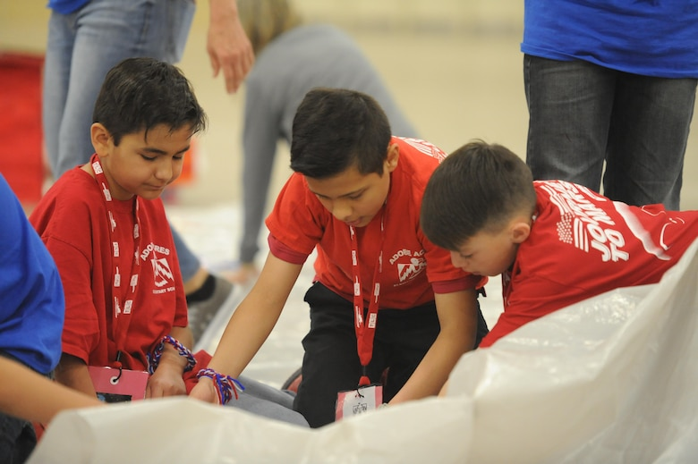 Fifth grade students from Albuquerque participate in Mission to Mars, a program hosted by Kirtland's Air Force Research Laboratory. Students are tasked with writing sagas to describe their journey to mars, studying Mars facts and designing a life support system model. The activities are specifically designed to fit into the science, technology, engineering, and math (STEM) curriculum.