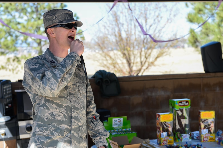 "Chaplain (Capt.) Portmann Werner, 50th Space Wing chaplain, discusses the rules of engagement for the 2nd Annual Easter Egg Hunt hosted by the chaplains' office at Schriever Air Force Base, Colorado, Wednesday, April 12, 2017.  Werner allowed for ""slight contact"" through the competition as Airmen competed for the 12 golden eggs among the 1,400 eggs hidden.  (U.S. Air Force photo/Christopher DeWitt)"