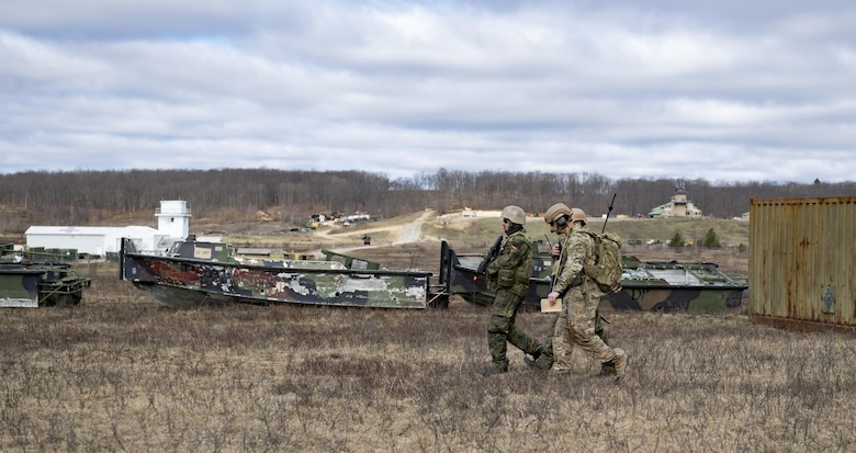 Airmen from the 19th Air Support Operations Squadron and the German air force travel across Camp Grayling, Mich., during a close air support exercise, April 12, 2017. To further build interoperability and hone their unique skillset, members of the German air force Air Ground Operations Squadron travelled to the U.S. to partner with the 19th ASOS and conduct a close air support exercise working with A-10C Thunderbolts IIs and F-16 Fighting Falcons. (U.S. Air Force photo by Airman 1st Class Daniel Snider)