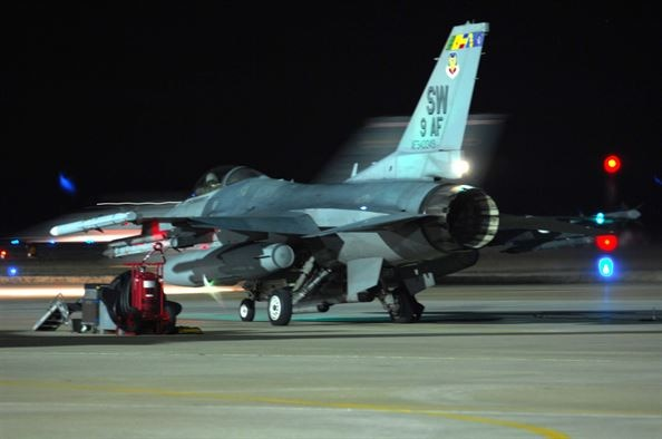 A U.S. Air Force pilot assigned to the 55th Fighter Squadron prepares for night training in a F-16CM Fighting Falcon at Shaw Air Force Base, S.C., Jan. 15, 2008. Night flying prepares pilots and ground crew members for tasks they may face during real combat operations while deployed. (U.S. Air Force photo by Airman 1st Class William Coleman)