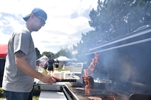 U.S. Air Force Senior Master Sgt. David Clark, 17th Training Wing first sergeant, cooks burgers during sports day near the Mathis Fitness Center on Goodfellow Air Force Base, Texas, April 14, 2017. The Top 3 supported the 17th Force Support Squadron's burger burn by providing volunteers to cook and monitor food. (U.S. Air Force photo by Staff Sgt. Joshua Edwards/Released)