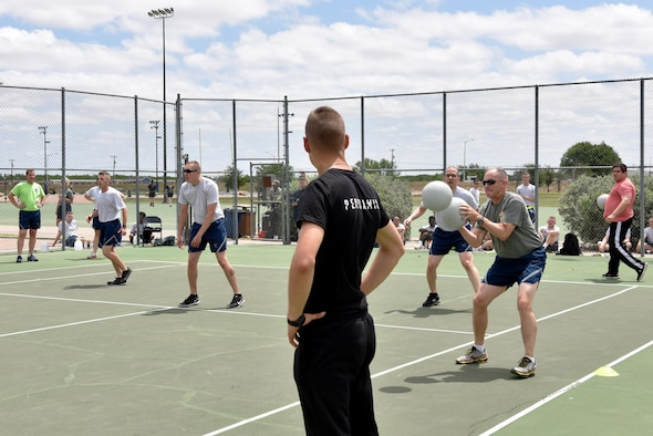U.S. Air Force Col. Michael Downs, 17th Training Wing Commander, deflects a dodgeball during sports day at the Mathis Fitness Center dodgeball court on Goodfellow Air Force Base, Texas, April 14, 2017. Sports day featured volleyball, softball, basketball and more. (U.S. Air Force photo by Staff Sgt. Joshua Edwards/Released)