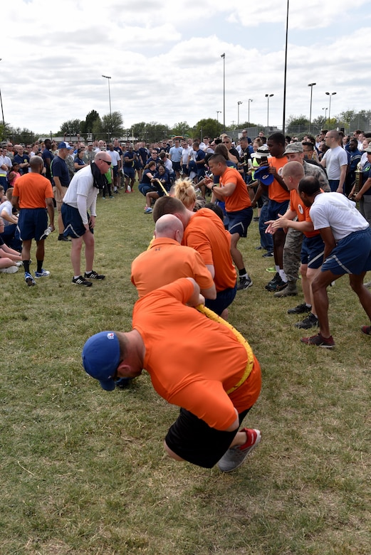 17th Training Support Squadron and 315th Training Squadron compete in tug-of-war during sports day near the Mathis Fitness Center track on Goodfellow Air Force Base, Texas, April 14, 2017. This was the final match that determined the overall winner for the day. (U.S. Air Force photo by Staff Sgt. Joshua Edwards/Released)