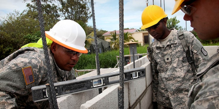 U.S. Soldiers with the 808th Engineer Company, check to insure that a cinder block wall is level while working at a construction site for a new health clinic at Ladyville, Belize, April 13, 2017. Soldiers with the 808th are building a new clinic at the Ladyville Health Center as a part of Beyond the Horizon 2017. A total of five construction projects will take place during the exercise. BTH 2017 is a U.S. Southern Command-sponsored, Army South-led exercise designed to provide humanitarian and engineering services to communities in need, demonstrating U.S. support for Belize. (U.S. Army Photo by Sgt. Joshua E. Powell)