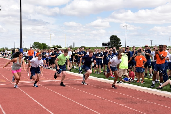Runners begin the mile relay during sports day at the Mathis Fitness Center track on Goodfellow Air Force Base, Texas, April 14, 2017. The relay was the last chance for teams to earn points before the final four showdown. (U.S. Air Force photo by Staff Sgt. Joshua Edwards/Released)