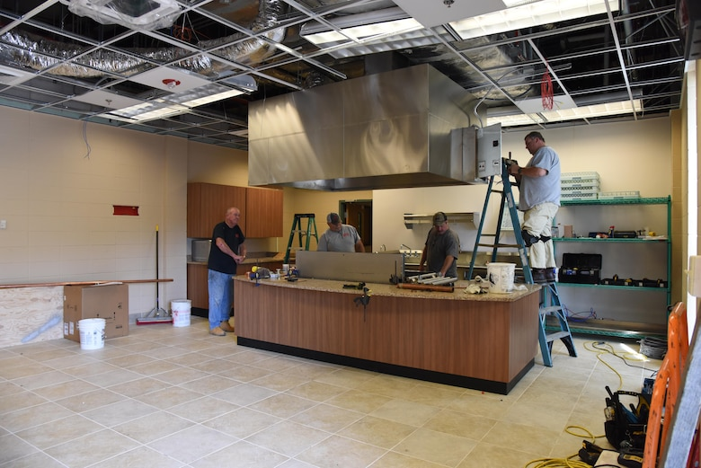 R and R Food Service installers install kitchen appliances at McBride Commons April 11, 2017, on Keesler Air Force Base, Miss. The McBride Commons renovation project will transition the former base library into a common area for those with base access, which includes a children's library, computer stations, engraving, framing, marketing and print shops and a full kitchen. The planned completion date for the nine-month project is May 2017. (U.S. Air Force photo by Kemberly Groue)