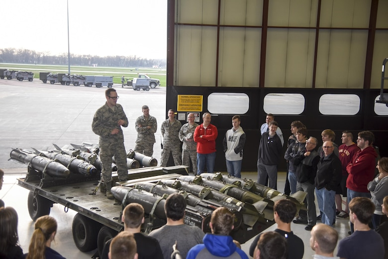 Staff Sgt. Ethan Dellman, 114th Maintenance Squadron ordinance system mechanic, explains his career field to attendees of the first night flying career day April 13, 2017, Joe Foss Field, S.D. Career day allows students, parents, and others who are interested in the South Dakota Air National Guard to see and learn about the different vocations the 114th Fighter Wing Airmen perform on a daily basis. (U.S. Air National Guard photo by Staff Sgt. Duane Duimstra/Released)