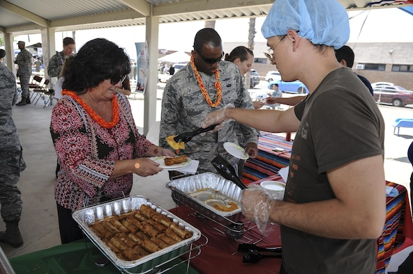 A volunteer serves Hispanic food during a cultural awareness festival at Davis-Monthan Air Force Base, Ariz., April 17, 2017. The festival included informational booths, food tastings, guest speakers and live events from different cultures, ethnicities and groups.  (U.S. Air Force photo by Airman 1st Class Mya M. Crosby)