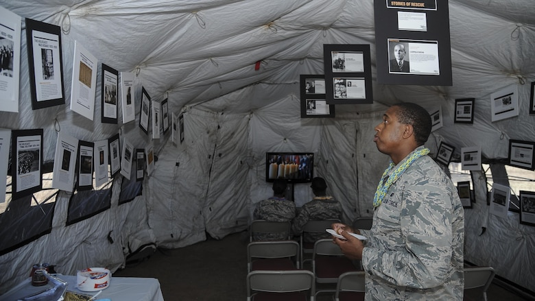 U.S. Air Force 1st Lt. Allante Staten, 355th Fighter Wing deputy chief of protocol, views articles from the Holocaust during a cultural awareness festival at Davis-Monthan Air Force Base, Ariz., April 17, 2017. The festival, titled Strengthening Resiliency through Diversity, showcased the unique characteristics of several different cultures and groups. (U.S. Air Force photo by Airman 1st Class Mya M. Crosby)