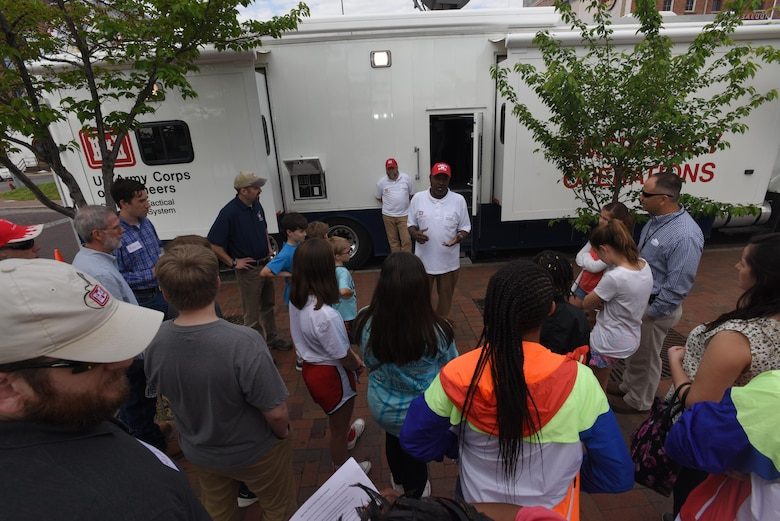"""James Sowell and Tim Rochelle, emergency managers with the U.S. Army Corps of Engineers Nashville District, lead a tour of a command and control vehicle parked at Riverfront in Nashville, Tenn., as part of the district's """"Take Your Kids to Work Day"""" activities April 14, 2017."""