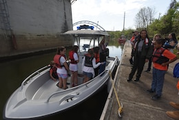 "Kids board a Corps of Engineers patrol boat on the Cumberland River and learn about boating safety as part of the district's ""Take Your Kids to Work Day"" activities at Riverfront in Nashville, Tenn., April 14, 2017."