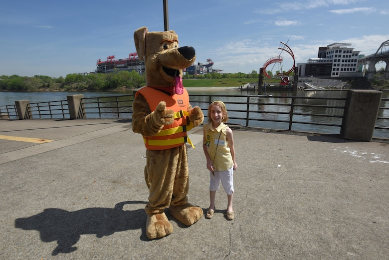 """Carina Long, 9, celebrates her birthday with Bobber the Water Safety Dog at Riverfront in Nashville, Tenn., April 14, 2017.  She learned that wearing a life jacket is the best way to stay safe around the water while participating in """"Take Your Kids to Work Day"""" activities with her dad Brad Long, Soils and Dam Safety chief."""