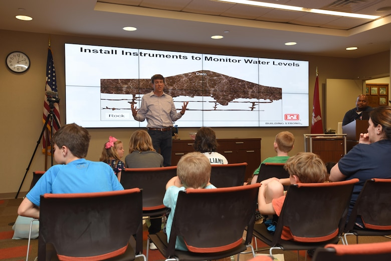 """Mark Elson, Civil Design Branch Geology Section, talks about the challenges of limestone in the geology of a dam to kids as part of the district's """"Take Your Kids to Work Day"""" activities at the district headquarters in Nashville, Tenn., April 14, 2017."""