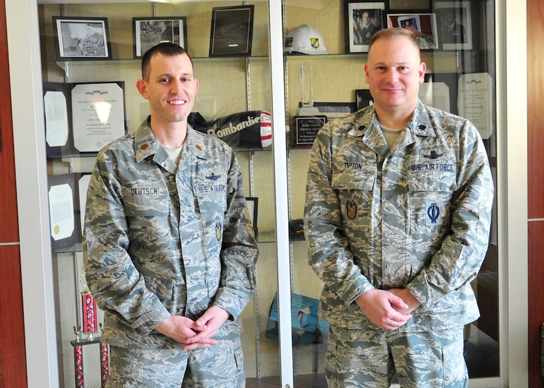 SCHREIVER AIR FORCE BASE, Colo. -- Maj. Paul Deutsch, Director of the 310th Space Wing Inspector General Complaints Resolution Program, and Lt. Col. Jerade Tipton, 310th SW/IG Complaints Resolution Management, stand in front of the wings awards display case on Sunday, Mar. 5th, 2017. The team won the 2016 John P. Flynn award due to their embodiment of integrity, justice, compassion, loyalty, courage and spirit within their office. (U.S. Air Force photo/Senior Airman Laura Turner)