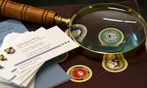 SCHREIVER AIR FORCE BASE, Colo. -- Lt. Col. Jerade Tipton, 310th Space Wing Inspector General Complaints Resolution Management, keeps a magnifying glass on his desk as a reminder to be thorough during each investigation, shown Tuesday, Apr. 18th, 2017. A magnifying glass can also be found on the IG badge, a symbol to identify Inspectors General who have legal authority to audit, investigate, and inquire into all activities of the forces they inspect. (U.S. Air Force photo/Senior Airman Laura Turner)