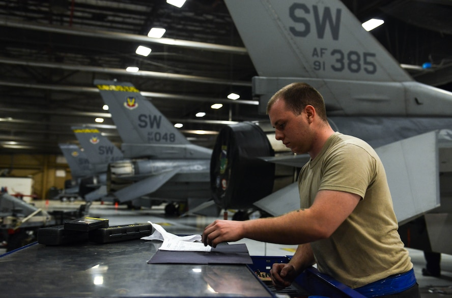 U.S. Air Force Airman 1st Class Ryan Cassidy, 20th Aircraft Maintenance Squadron tactical aircraft maintainer, looks through a toolbox log at Shaw Air Force Base, S.C., April 13, 2017. Tactical aircraft maintainers use logs to keep accountability of tools at all times. (U.S. Air Force photo by Airman 1st Class Destinee Sweeney)