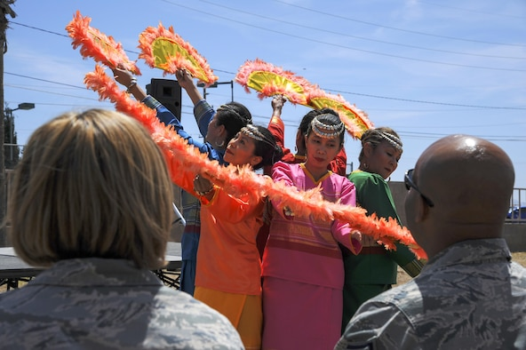 Dancers from the Filipino – American Sampaguita Club of Tucson perform during the cultural awareness festival at Davis-Monthan Air Force Base, Ariz., April 17, 2017. The festival was held to combine the Department of Defense supported-observances into one family-friendly, annual event. (U.S. Air Force photo by Airman 1st Class Mya M. Crosby)