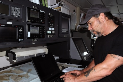 James Howell, a marine surveyor at the 99th Regional Support Command's Area Maintenance Support Activity 83 at Curtis Bay, Maryland, check reports April 17 aboard the Major General Robert Smalls (LSV-8).  AMSA 83 is one of two locations in the 99th Regional Support Command's footprint that maintain watercraft. The AMSA provides technical assistance and maintenance support to the 949th Transportation Company along with the 203rd Transportation Detachment.