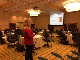 Contract Officer Holly Watson answers a question posed by the attendees at the RLB Industry Day, April 12.