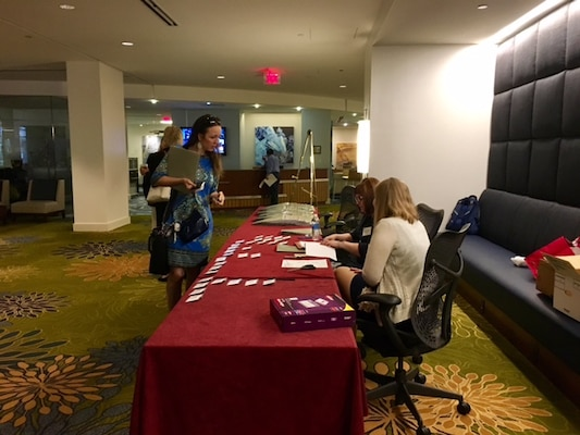 Middle East District team members Becky Moser and Lacey Sandate welcome and register industry officials to the informational event in Herndon, Va., Wednesday, April 12.