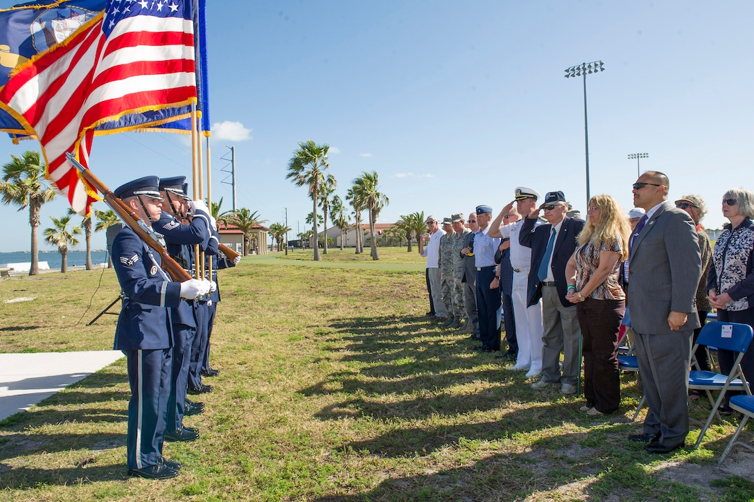 Members of the audience salute the American Flag during the playing of the National Anthem at the Banana River Naval Air Station monument unveiling ceremony April 11, 2017, at Patrick Air Force Base, Fla. The 45th Space Wing hosted a dedication ceremony for the Martin PBM-5 Mariner Memorial honoring 13 service members who lost their lives during a rescue mission supporting the 1945 disappearance of Flight 19.  (U.S. Air Force photo by Phil Sunkel)
