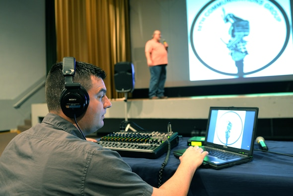 Zack Loomis (left) and Franl Molish from 88th Communications Squadron/AV Support set up audio visual equipment at the base theater in the Kittyhawl Center.