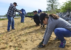 Volunteers plant sea-meadow grass along the James River shoreline on Fort Eustis during Earth Week events at Joint Base Langley-Eustis, Va., April 18, 2017. Approximately 1000 plants were planted to create artificial wetlands, which will help prevent severe flooding and reduce the effects of erosion. (U.S. Air Force photo/Tech. Sgt. Katie Gar Ward)
