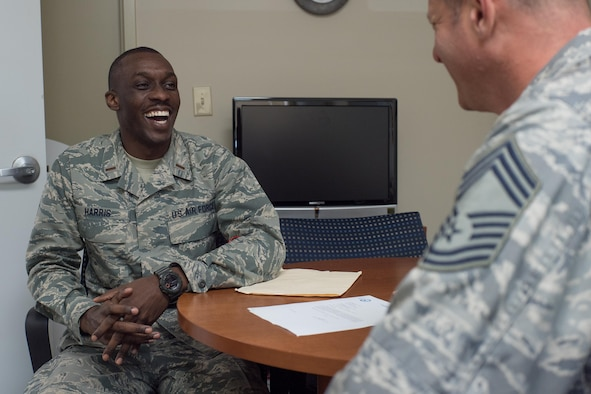 Second Lt. D'Anthony Harris, 413th Aeromedical Staging Squadron medical readiness officer, shares a laugh with Chief Master Sgt. Duwayne Albrecht, 413th ASTS senior air reserve technician, April 18, 2017, at Robins Air Force Base, Georgia. Harris served in the unit as a mental health technician before commissioning as a Medical Service Corps officer last year. (U.S. Air Force photo by Jamal D. Sutter)
