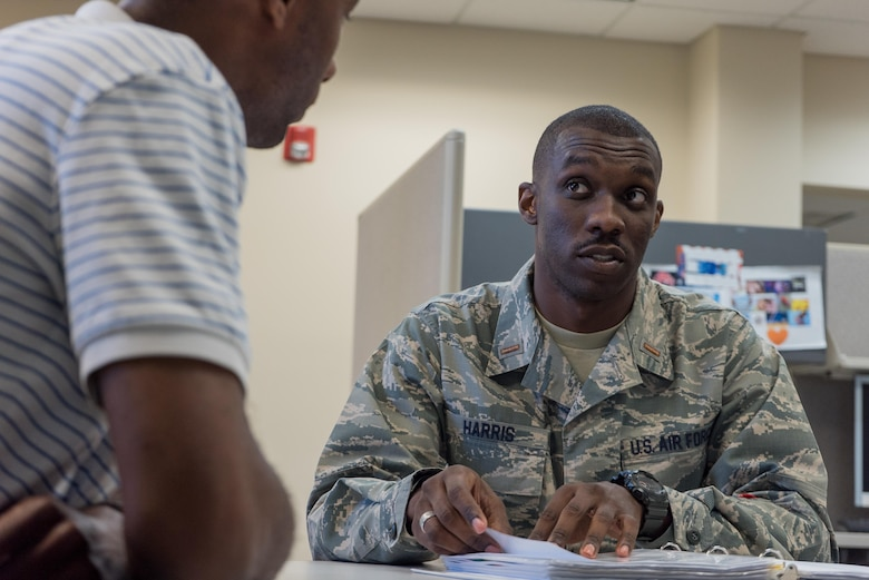 Second Lt. D'Anthony Harris, 413th Aeromedical Staging Squadron medical readiness officer, speaks about unit training with Walter Ware Jr., 413th ASTS in-service trainer, April 18, 2017, at Robins Air Force Base, Georgia. Harris is also a master resiliency trainer with the Air Force Reserve Yellow Ribbon Program. (U.S. Air Force photo by Jamal D. Sutter)