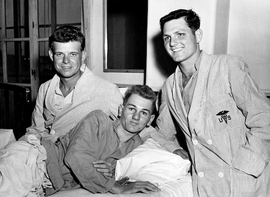 "HQ, FEAF, TOKYO --- Following their return to Japan after release, the first three U. S. Air Force repatriates relax at an Army hospital in Tokyo.  The three (left to right) are Capt. Zach W. Dean of El Dorado, Kansas, an F-51 Mustang pilot shot down on April 22, 1951; A/2C Robert L. Weinbrandt of El Cajon, California, a B-29 ""Super Fortress tail gunner captured after his plane was shot down the night of January 28 29, 1953, and A/2C William R. Hilycord of  Columbus, Indiana., a B-26 Invader air crewman held since December, 1951."