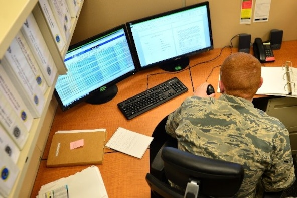 U.S. Air Force Airman Brendan Harrah, 20th Contracting Squadron (CONS) contracting specialist, reviews a contract at Shaw Air Force Base, S.C., April 11, 2017. Airmen assigned to the 20th CONS manage funding for contractors on base who work on tasks ranging from building renovations to road construction. (U.S. Air Force photo by Airman 1st Class Christopher Maldonado)
