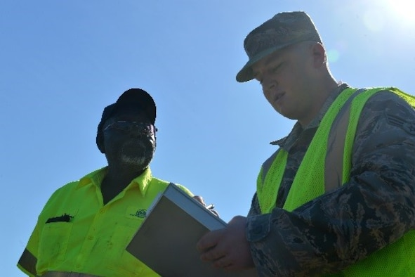 U.S. Air Force Senior Airman Aaron Kelly, 20th Contracting Squadron (CONS) infrastructure contracting officer, speaks with a contractor at Shaw Air Force Base, S.C., April 11, 2017. Airmen assigned to the 20th CONS infrastructure flight perform work condition checks on all contractors to check for hours worked, current pay conditions and quality of work. (U.S. Air Force photo by Airman 1st Class Christopher Maldonado)