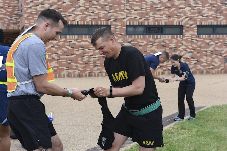 Competitors attempt to unfold frozen T-shirts at the 7th annual Sexual Assault Response Coordinator Challenge on Goodfellow Air Force Base, Texas, April 14, 2017. The challenge raised awareness of sexual assault prevention and response through engaging participants in games and riddles. (U.S. Air Force photo by Airman 1st Class Chase Sousa/Released)