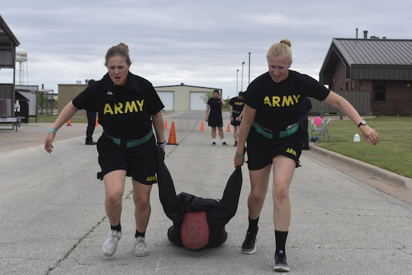 344th Military Intelligence Battalion students drag a dummy at the 7th annual Sexual Assault Response Coordinator Challenge on Goodfellow Air Force Base, Texas, April 14, 2017. Participants had to complete the task in order to move onto the next one. (U.S. Air Force photo by Airman 1st Class Chase Sousa/Released)