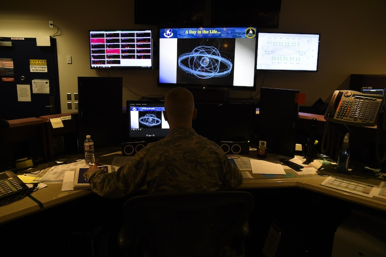 Maj. Gregory Stewart, 22nd Space Operations Squadron mission commander, oversees the Air Force Satellite Control Network antennas from all over the world to ensure they are operating efficiently and providing support to the users at Schriever Air Force Base, Colorado, Wednesday, April 5, 2017. On average, the AFSCN enables more than 450 satellite contacts per day. (U.S. Air Force photo/Tech. Sgt. Julius Delos Reyes)