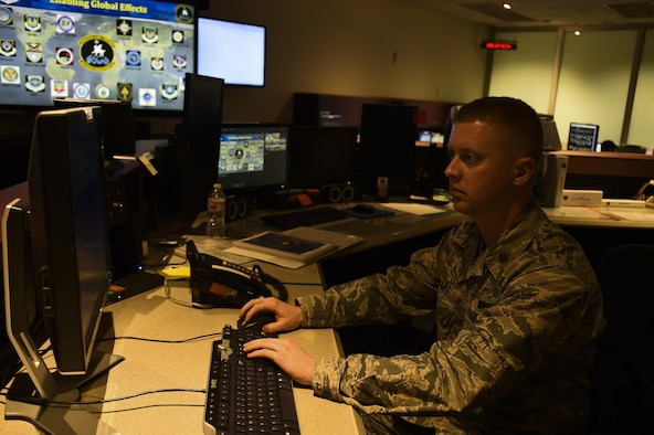 Maj. Gregory Stewart, 22nd Space Operations Squadron mission commander, supervises the Air Force Satellite Control Network schedulers at Schriever Air Force Base, Colorado, Wednesday, April 5, 2017. The schedulers provide support to 50th Space Wing units, several Air Force Space Command missions as well as other government agencies, such as NASA and National Oceanic and Atmospheric Administration. (U.S. Air Force photo/Tech. Sgt. Julius Delos Reyes)