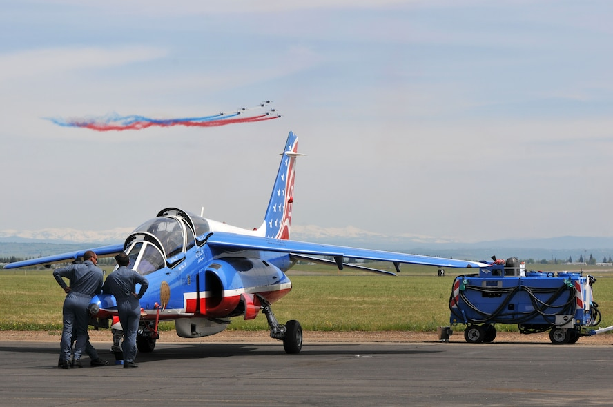Crew members of Patrouille de France watch an aerial demonstration at Mather Air Field in Sacramento, California, April 15, 2017. (U.S. Air Force photo/Staff Sgt. Rebeccah Anderson)