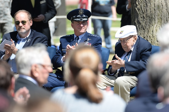 Chief of the Staff of the Air Force General David L. Goldfein, applauds during the 75th Anniversary of the Doolittle Raid Memorial Ceremony at the National Museum of the United States Air Force, April 18, 2017. Gen. Goldfein, who spoke at the ceremony, paid tribute to the Doolittle Raiders, to include Lt. Col. (Ret.) Richard E. Cole, the sole surviving member of the Doolittle Raiders (right), and Staff Sgt. David Thatcher, who passed in June 2016. Also attending the ceremony were friends and family of the Doolittle Raiders, including Sgt. Thatcher's son, Jeff Thatcher (left). (U.S. Air Force Photo by Wesley Farnsworth)