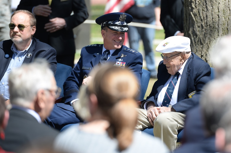 Chief of the Staff of the Air Force, Gen. David L. Goldfein, talks to Lt. Col. (Ret.) Richard E. Cole, the sole surviving member of the Doolittle Raiders (right) during the 75th Anniversary of the Doolittle Raid Memorial Ceremony at the National Museum of the United States Air Force, April 18, 2017. Also attending was Jeff Thatcher (left), the son of Doolittle Raider Staff Sgt. David Thatcher, who passed in June 2016. (U.S. Air Force Photo/ Wesley Farnsworth)