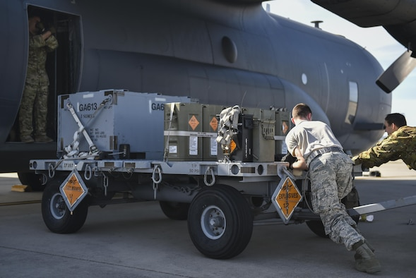 Air Commandos push an ammunition cart to an AC-130U Spooky gunship at Hurlburt Field, Fla., April 17, 2017. The AC-130U is equipped with a 25mm Gatling gun, 40mm and 105mm canons, and can take off carrying more than 150,000 pounds of cargo. (U.S. Air Force photo by Airman 1st Class Joseph Pick)